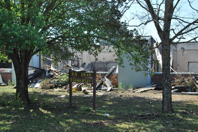 <p>A sign stands Wednesday on the vacant campus of R.B. Dean Elementary School in Maxton after one building next to the gymnasium caught fire in the early morning hours.</p>
