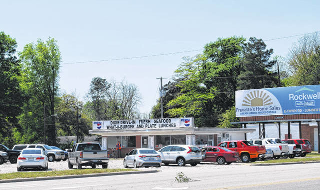 Vehicles fill the parking lot of the Dixie Drive-In in Lumberton on Tuesday afternoon. The business reopened after completing repairs made necessary when a vehicle crashed into the building in January.