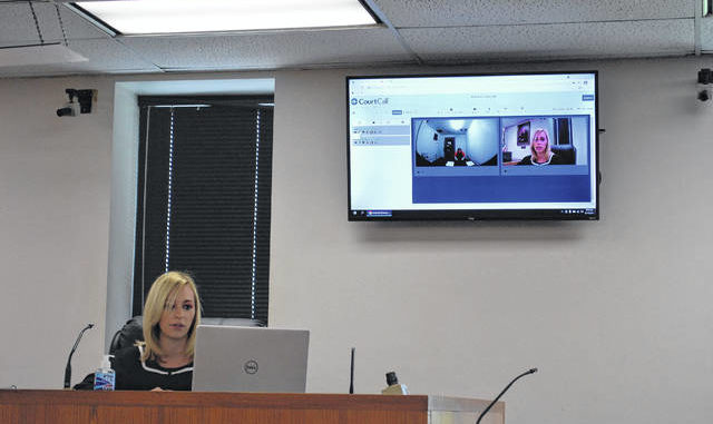 Robeson County Chief District Court Judge Angelica Chavis McIntyre, left, speaks via video CourtCall with 29-year-old Dejywan R. Floyd at his second court appearance. Floyd is charged in connection with the March 25 shooting that left a 47-year-old Pennsylvania woman dead on Interstate 95.