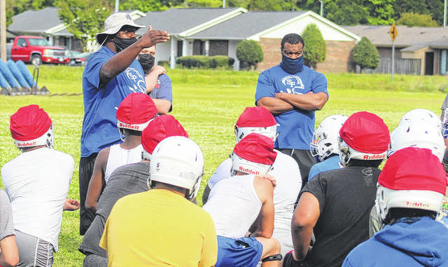 Chris Stiles | The Robesonian                                 St. Pauls football coach Mike Setzer talks with the Bulldogs during practice on Tuesday in St. Pauls. The Bulldogs host SouthWest Edgecombe in the second round of the 2AA state playoffs Friday.