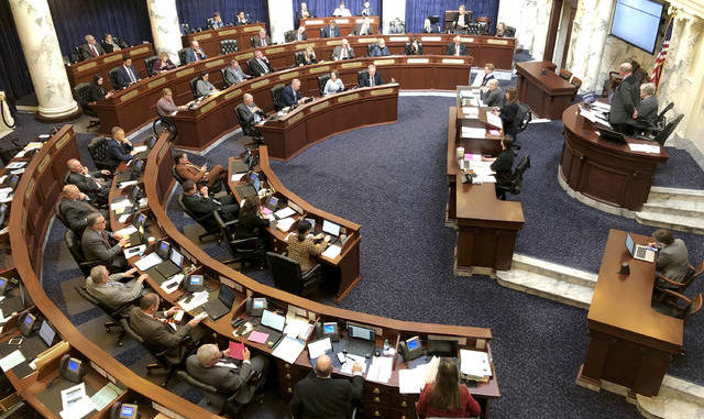 In this Feb. 27, 2020, photo, members of the Idaho House of Representatives debate legislation in the Idaho Statehouse in Boise. Idaho lawmakersapproved legislation banning transgender people from changing the sex listed on their birth certificates despite a federal court ruling declaring such a ban unconstitutional.                                  AP file photo