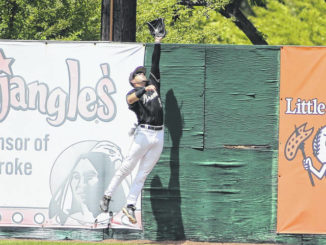 UNCP Athletics                                 UNC Pembroke's Trevor Clemons makes a leaping catch at the wall during Sunday's Peach Belt Conference semifinal series against Columbus State.