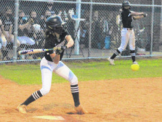 Chris Stiles | The Robesonian                                 Lumberton's August Smith swings at a pitch during an April 6 game against Purnell Swett. Smith was named Sandhills Athletic Conference Player of the Year.