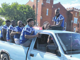 Chris Stiles | The Robesonian                                 The St. Pauls football team participated in a parade Saturday, two days after their first state championship appearance. The event honoring NCHSAA 2AA East Regional champions was part of a car show being held in downtown St. Pauls; fireworks were shot off after the parade.