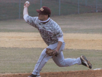 Chris Stiles | The Robesonian                                 Lumberton's Bobby Baxley throws a pitch during Tuesday's game at Fairmont.