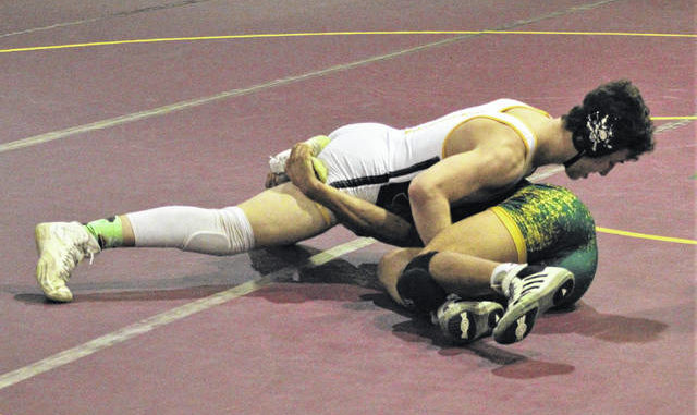 Chris Stiles | The Robesonian                                 Lumberton's Jackson Buck wrestles against West Forsyth's Landon Hairston during Friday's match in Lumberton. Buck is undefeated this season and was named Sandhills Athletic Conference Wrestler of the Year.