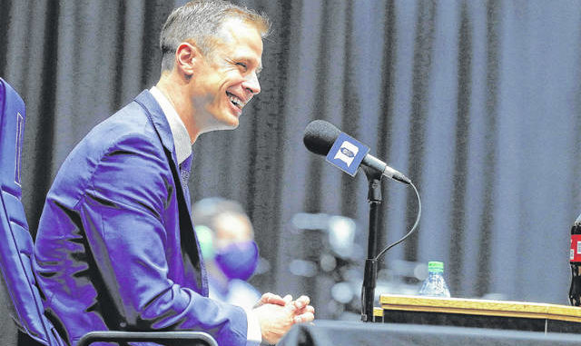 Ethan Hyman   The News & Observer via AP                                 Jon Scheyer laughs during a press conference at Cameron Indoor Stadium in Durham Friday. Scheyer will spend the upcoming year in his role as associate head coach as coach Mike Krzyzewski chases one more championship in a Hall of Fame career. Then it's up to the 33-year-old Scheyer to take over ahead of the 2022-23 season in the program's first coaching change in more than four decades.