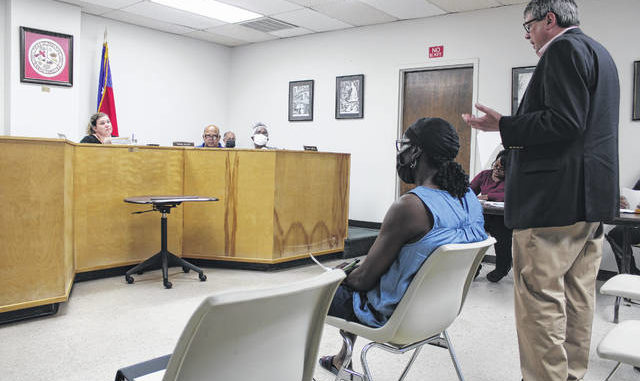 John Masters, of S. Preston Douglas and Associates, presents the Fiscal Year 2019-20 audit report to the Rowland Board of Commissioners on Tuesday.                                  Tomeka Sinclair   The Robesonian