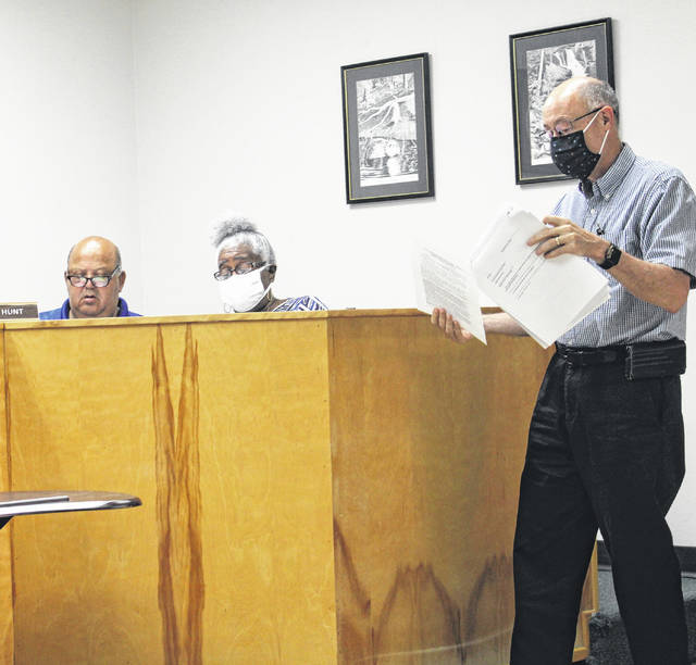 <p>Rowland Attorney Robert Price discusses zoning laws with the Rowland Board of Commissioners during a regular business meeting held Tuesday.</p>                                  <p>Tomeka Sinclair   The Robesonian</p>