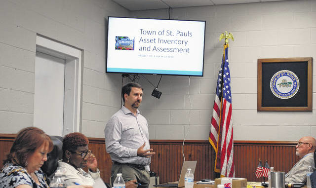 David Honeycutt, of McGill Associates, presents information from a town sewer study Thursday during a St. Pauls Board of Commissioners meeting, as commissioners listen to his report.