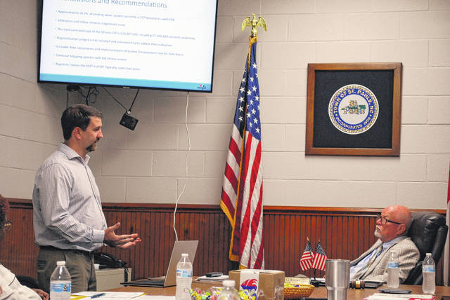 <p>David Honeycutt, of McGill Associates, speaks Thursday to St. Pauls Mayor Elbert Gibson during a presentation on the condition of the town's sewer system, including needed repairs. Honeycutt made his presentation during a regular business meeting of the town Board of Commissioners.</p>
