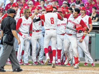 Wolfpack top No. 1 Arkansas, advance to CWS