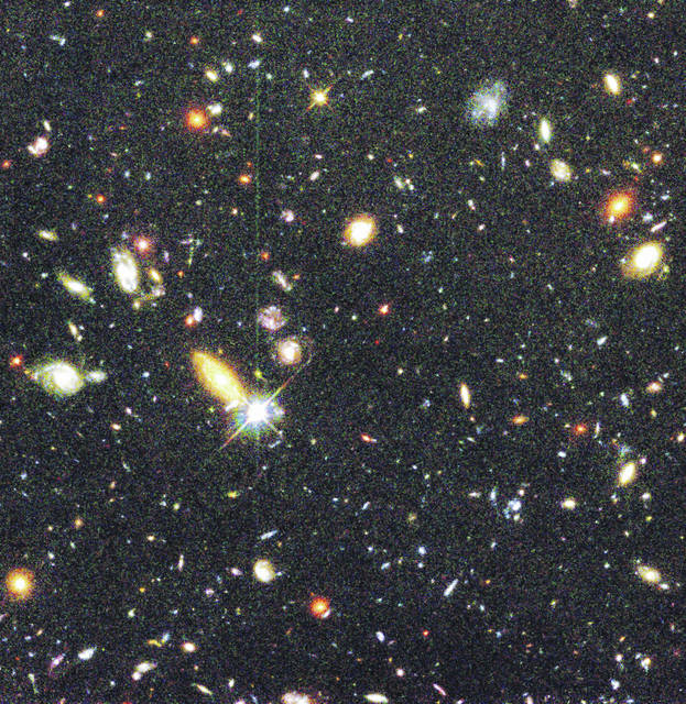 <p>There is only one individual star, the rest are galaxies, as depicted in an image take taken by the Hubble Space Telescope. In general, the redder ones are further away.</p>