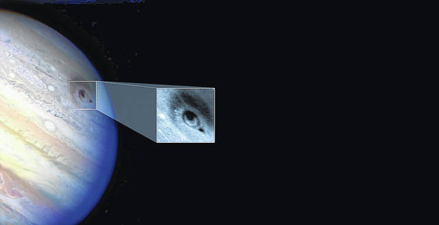 <p>Shown is an image taken by the Hubble Space Telescope that shows an impact scar from a larger piece of the comet exploding in Jupiter's atmosphere.</p>