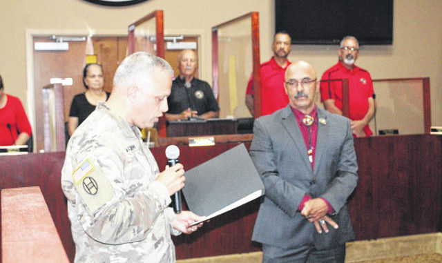 Col. Micheal Marciniak, director of Strategic Plans and Policies for the National Guard, presents Lumbee Tribal Councilman Terry Hunt with the North Carolina Association Certificate and the Old North State Award for his 28 years of service in the U.S. Army and National Guard. The presentation occurred at the Council's monthly business meeting.                                  Tomeka Sinclair | The Robesonian