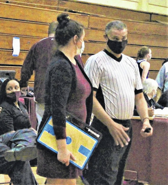 <p>Chris Stiles   The Robesonian</p>                                 <p>Lumberton girls basketball coach Ivy Johnson, left, discusses a call with official Anthony Maynor during a Feb. 17 game against Scotland. Maynor was recently awarded the North Carolina High School Athletic Association's Dick Knox Distinguished Service Award, along with fellow official Adrian Lowery.</p>