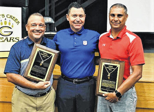 Contributed photo                                 Adrian Lowery, of Lumberton, and Anthony Maynor, of Pembroke, were both each recently recognized with the North Carolina High School Athletic Association's Dick Knox Distinguished Service Award for their work as game officials. Pictured, from left, are Lowery, NFL referee and Lumberton native Brad Allen, who presented the awards, and Maynor.
