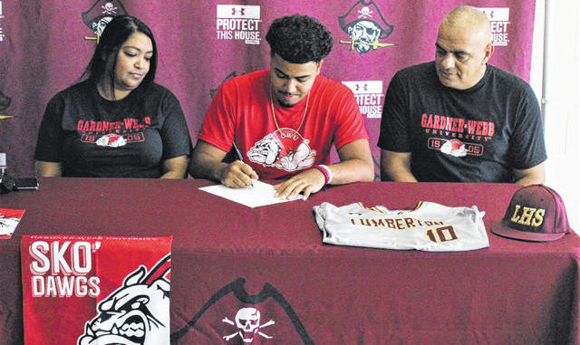 Chris Stiles | The Robesonian                                 Lumberton's Jacob Scott signed Wednesday to play baseball collegiately at Gardner-Webb University. He is pictured with his parents, John and Samantha Oxendine.