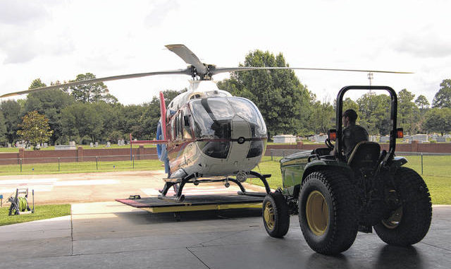 Mechanic Eric Corriher moves the AirLife North Carolina helicopter from its hangar in Lumberton on Wednesday.