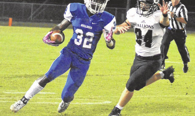 The Robesonian file photo                                 Marqueise Coleman, left, turns the corner while carrying the ball during a St. Pauls football game against South Columbus in 2018. Coleman died Wednesday as the result of a shooting in St. Pauls.