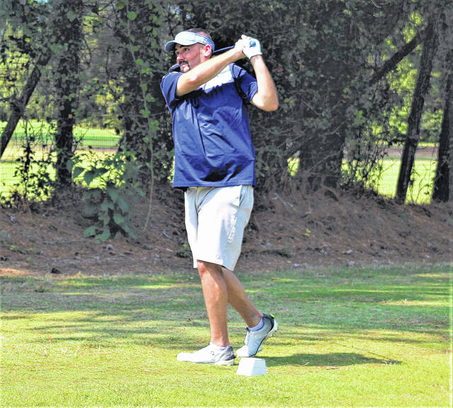 <p>Chris Stiles   The Robesonian</p>                                 <p>Brian Haymore hits his tee shot on the 18th hole during Saturday's round at the Robeson County Golf Championship. Haymore leads the Regular Division after a round of 74.</p>