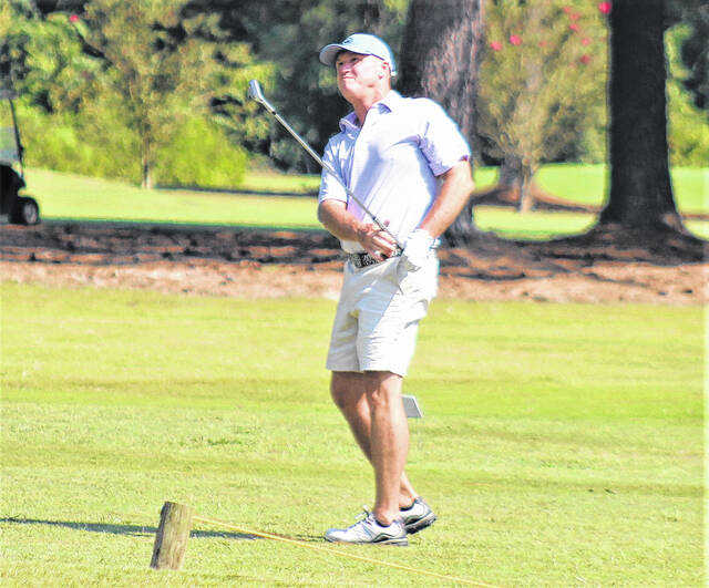 <p>Chris Stiles   The Robesonian</p>                                 <p>Scott Benton hits a pitch shot on the 11th hole in the final round of the Robeson County Golf Championship Sunday at Pinecrest Country Club.</p>