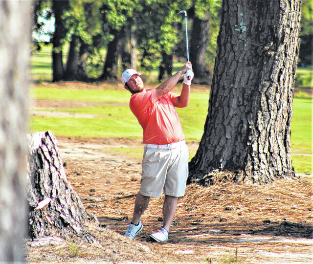 <p>Chris Stiles   The Robesonian</p>                                 <p>Ryan Bass hits his second shot on the 16th hole in the final round of the Robeson County Golf Championship Sunday at Pinecrest Country Club.</p>
