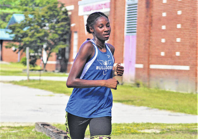 <p>Chris Stiles   The Robesonian</p>                                 <p>St. Pauls' Taliya Council approaches the finish line during Wednesday's cross country meet at Red Springs, which she won.</p>
