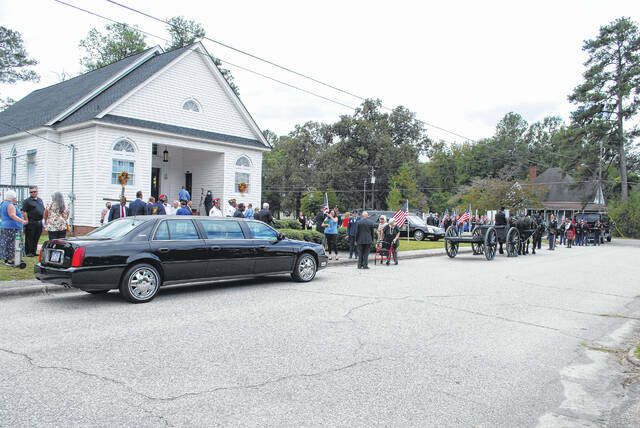 """<p>Shown is the crowd by Lumber Bridge Baptist Church Tuesday afternoon just before U.S. Army 1st Lt. James Earl """"Dick"""" Wright was transported from the church to the Oakdale Cemetery in Lumber Bridge. Wright returned Tuesday to Lumber Bridge for burial in the cemetery. He was killed in action during World War II.</p>"""