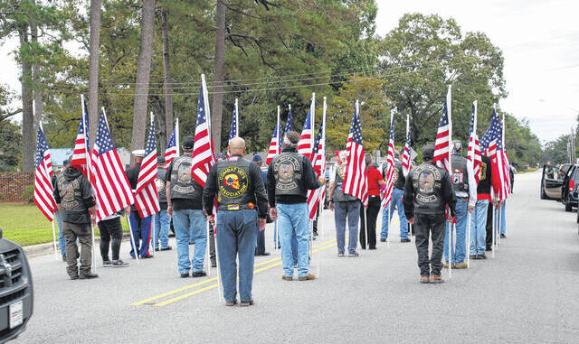 """Military veterans prepare Tuesday to march ahead of the funeral procession of U.S. Army 1st Lt. James Earl """"Dick"""" Wright who was after 77 years laid to rest in Lumber Bridge."""