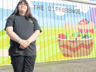 Maggie Underwood uses mural to challenge residents to 'Be the Difference'