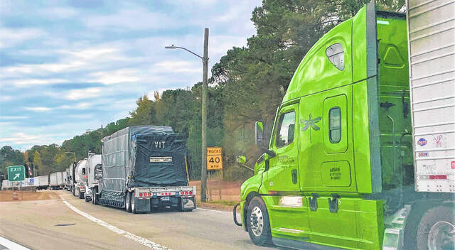 A line of semitrailers stretches nearly a quarter mile at the Southbound Weigh Station north of Lumberton. Local farmers are feeling the impact of supply chain issues faced across the U.S. Results from the impact are seen in delays of parts used to repair equipment, according to Mac Malloy, interim director of the N.C. Cooperative Extension's Robeson County Center.                                 David Kennard | The Robesonian                                  David Kennard | The Robesonian